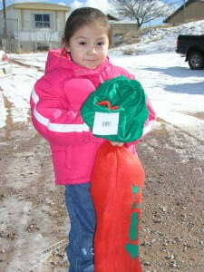 A little girl from Pojoaque with a big stocking